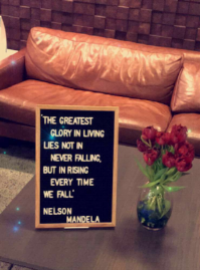 A message board in the Namely lobby