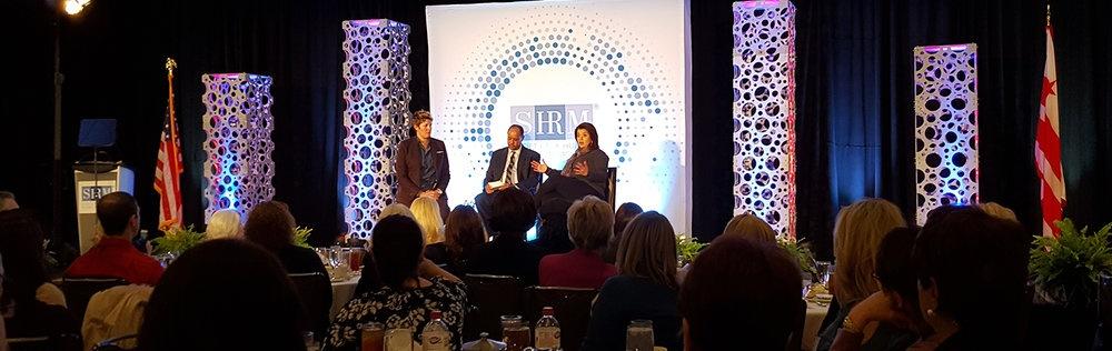 SHRM SVP Bob Carr led a discussion with CNN analysts Sally Kohn (left) and Ana Navarro (right).