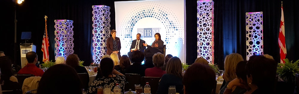 SHRM SVP Bob Carr led a discussion with CNN analysts Sally Kohn (left) and Ana Navarro (right).