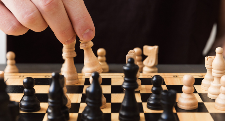 An employee plays chess during leadership training