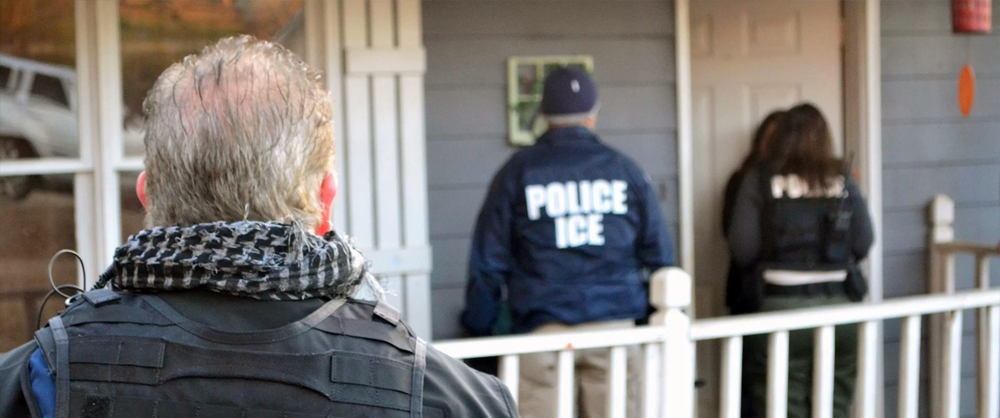 ICE Agents approaching a door