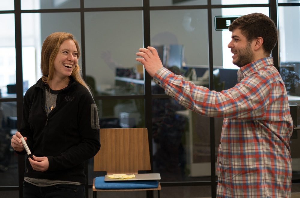 Katie Reed, Junior Software Developer, and Jack Foster, Copywriter, swap ideas.