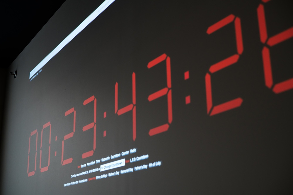 The hackathon countdown clock projected in the Namely kitchen.