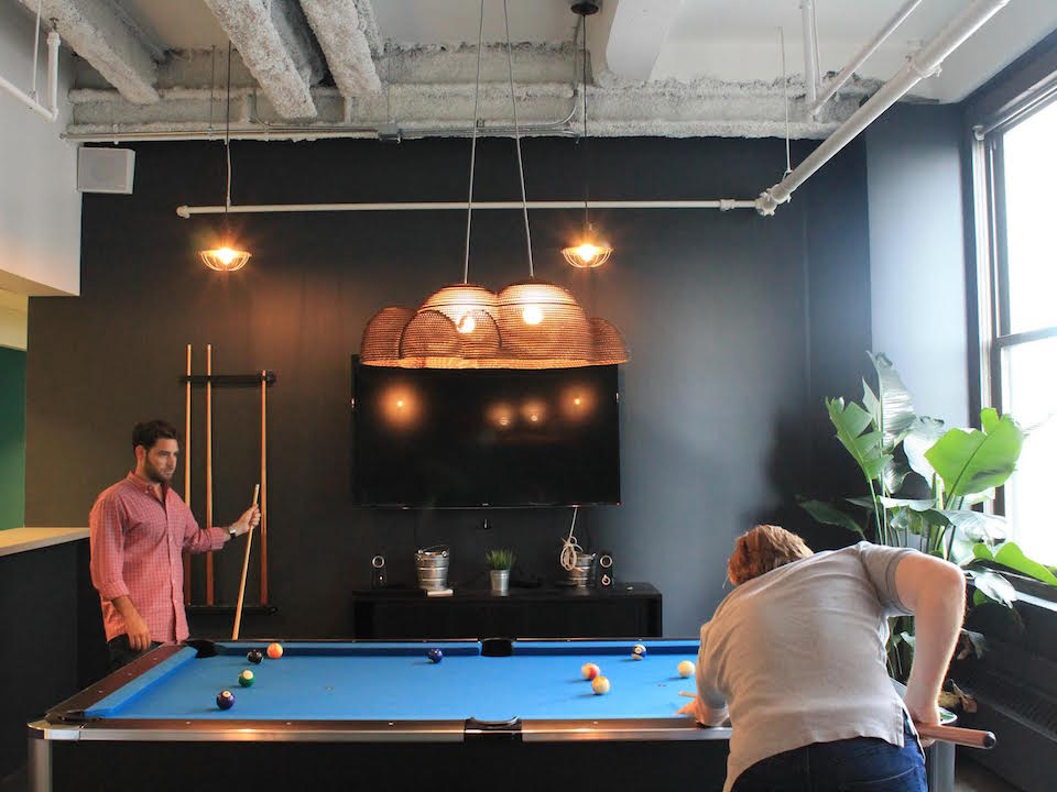 Employees take a well-earned pool break in the Magnetic offices.