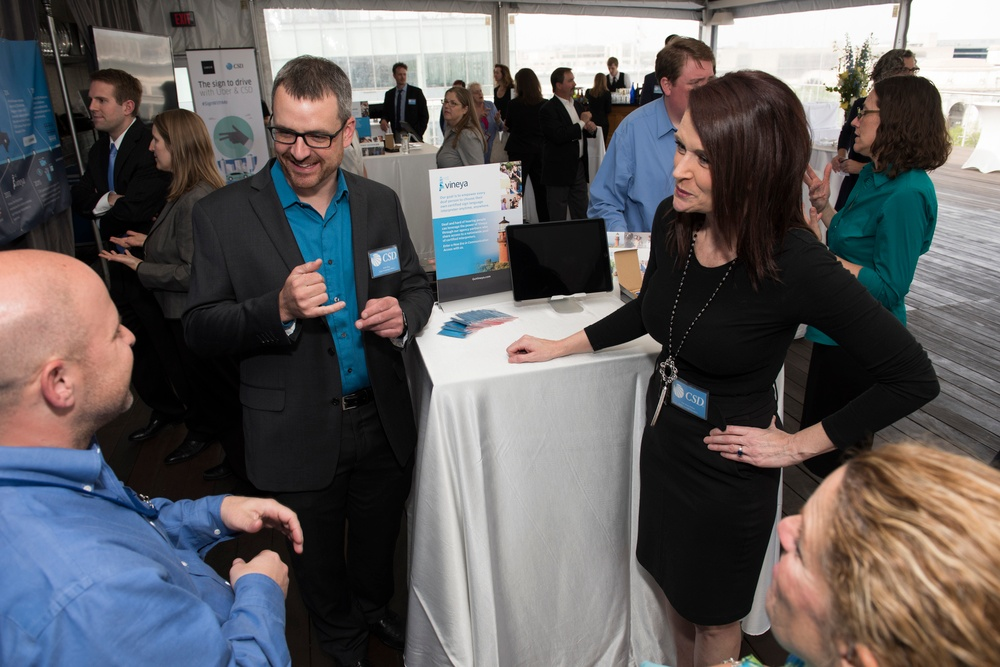Members of CSD share a laugh with a community member at the CSD@40 Expo, hosted last spring in Washington, D.C.