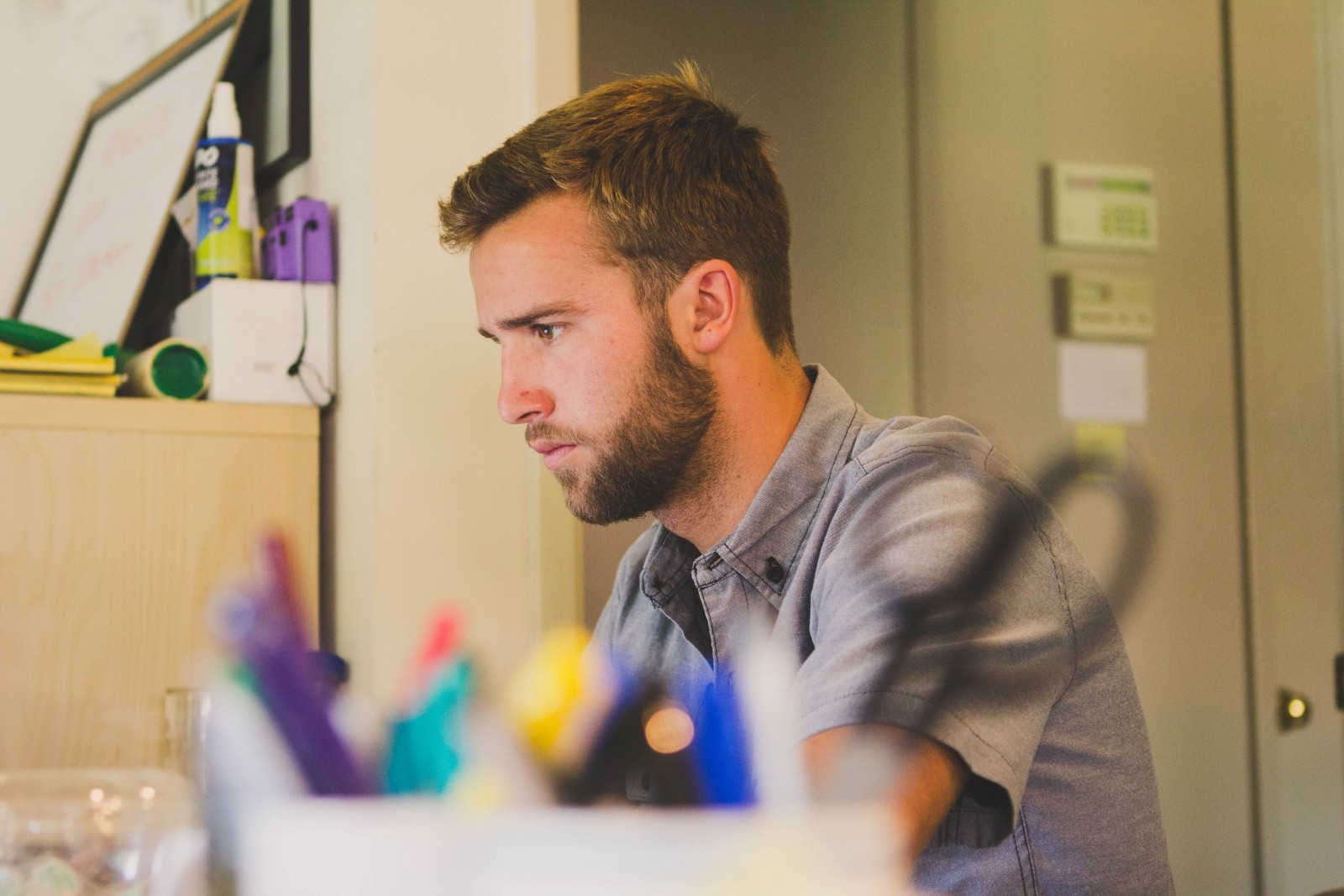 young-man-sitting-and-working-at-desk